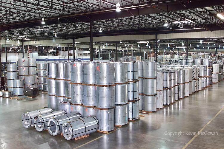 Sheet metal rolls at metal fabrication factory